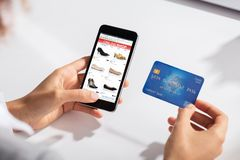 Free Woman Holding Credit Card In Hand Doing Online Shopping Stock Photo - 124738050