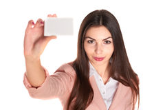Woman holding credit card isolated on white background Royalty Free Stock Photo