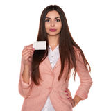 Woman holding credit card isolated on white background Royalty Free Stock Photos