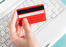 Woman holding a credit card for Royalty Free Stock Photography
