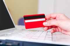 Woman holding a credit card for Stock Image