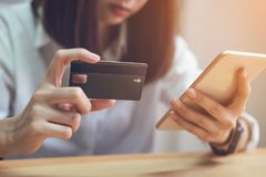 Woman holding credit card pay online and using smartphone for shop through the website. Royalty Free Stock Photography