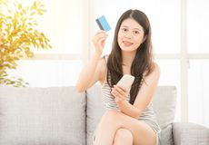 Woman holding credit card phone for shopping Royalty Free Stock Photo