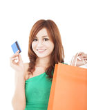 Woman holding credit card with shopping bag. Young woman holding credit card with shopping bag Royalty Free Stock Image