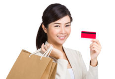 Woman holding credit card and shopping bag Royalty Free Stock Photo