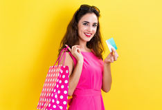 Woman holding a credit card and a shopping bag Stock Image