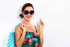 Woman holding a credit card and a shopping bag Stock Images