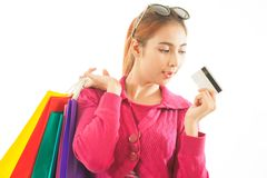 Woman holding credit card and shopping bags Royalty Free Stock Image
