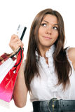 Woman holding credit card, shopping bags in hands Royalty Free Stock Images