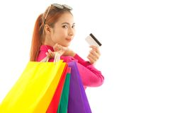 Woman holding credit card and shopping bags. Portrait of young asian woman holding credit card and shopping bags isolated on white background Stock Images