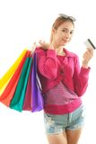 Woman holding credit card and shopping bags Royalty Free Stock Images