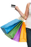 Woman holding credit card and shopping bags Royalty Free Stock Photography