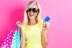 Woman holding a credit card and shopping bags Royalty Free Stock Image