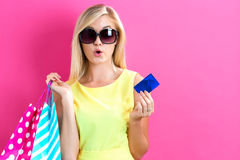 Woman holding a credit card and shopping bags Stock Image