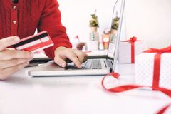Woman holding credit card and shopping online. New year, Christmas gift shopping Royalty Free Stock Image
