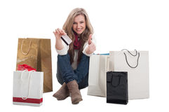 Woman holding credit card and showing thumbs up Royalty Free Stock Photo