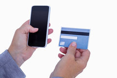 Woman holding credit card and smartphone Stock Photography