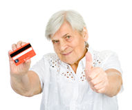 Woman holding credit card with thumbs up. looking Royalty Free Stock Photo