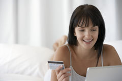 Woman Holding Credit Card And Using Laptop Royalty Free Stock Images