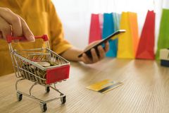 Woman holding credit card and using smartphone for shopping onli royalty free stock photos