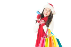 Woman holding credit card for winter christmas shopping. Woman holding credit card for winter christmas sale shopping with . happy excited with colorful shopping Stock Image