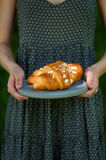 Woman holding croissants. Woman holding a croissant on a tray royalty free stock image