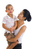 Woman holding a crying boy Stock Photos