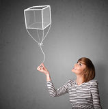 Woman holding a cube balloon Stock Photography