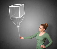 Woman holding a cube balloon Royalty Free Stock Images