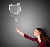 Woman holding a cube balloon Royalty Free Stock Photo