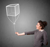Woman holding a cube balloon Stock Photo