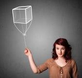 Woman holding a cube balloon Royalty Free Stock Photos
