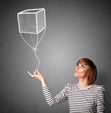 Woman holding a cube balloon Royalty Free Stock Photography