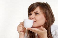 Woman holding a cup Royalty Free Stock Photography