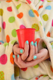 Woman holding a cup royalty free stock photos
