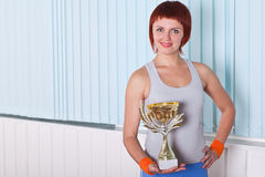 Woman holding cup awards Royalty Free Stock Photo