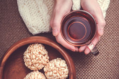 Woman holding cup of black tea Stock Photo