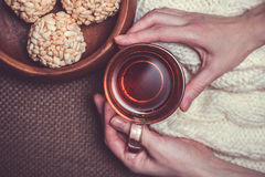 Woman holding cup of black tea Stock Photos