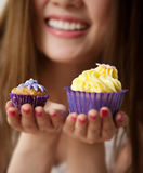 Woman holding a cup cake Royalty Free Stock Photo