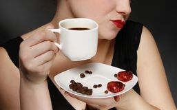 Woman holding a cup of coffee Royalty Free Stock Photos