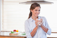 Woman holding a cup of coffee Stock Photography