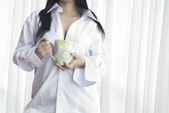 A woman holding a cup of coffee Stock Image