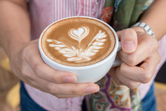Woman holding cup of coffee, close up. Woman holding cup of coffee, close up Stock Image