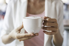 Woman holding cup of coffee Stock Image