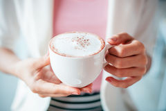 Woman holding cup of coffee Royalty Free Stock Image