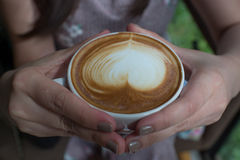Woman holding a cup of coffee Stock Photo