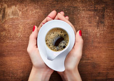 Woman holding cup of coffee Royalty Free Stock Photos