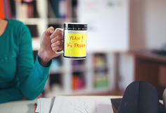 Woman holding a cup of coffee with a motivational message Royalty Free Stock Photography