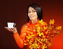 Woman holding  cup of coffee. Royalty Free Stock Images