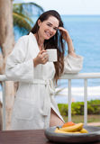 Woman holding a cup of coffee and smiling stock images